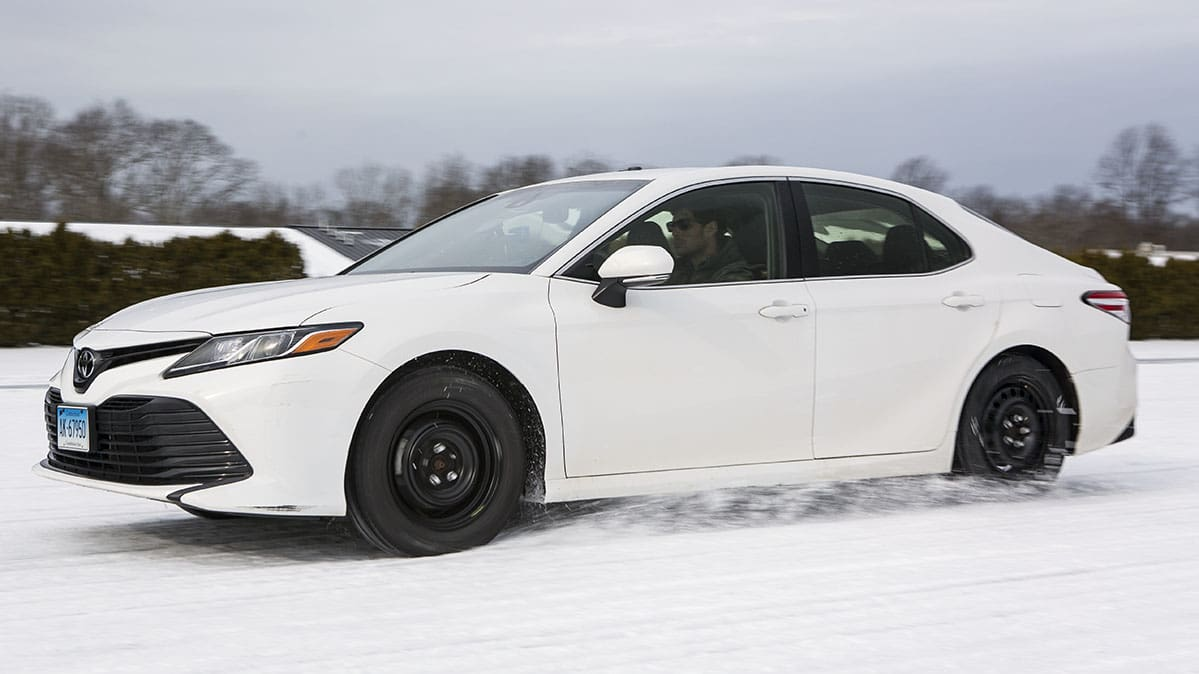 Toyota Camry with all-weather tires during winter tire testing.