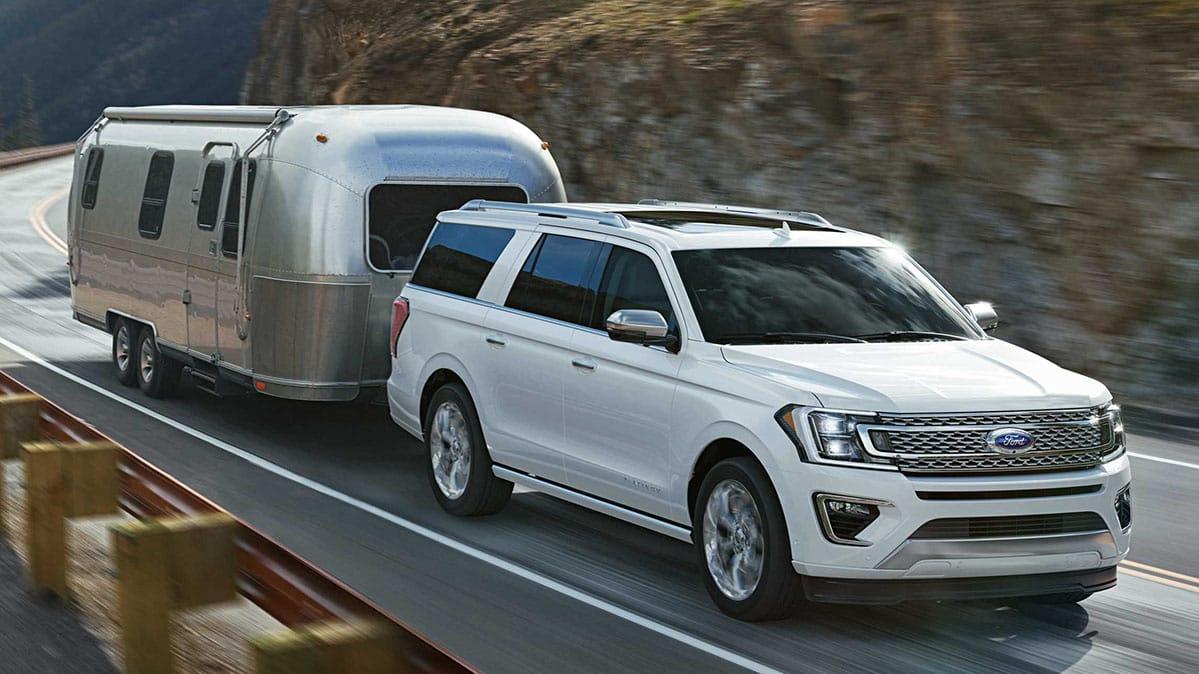 Ford Expedition pulling an Airstream RV trailer.