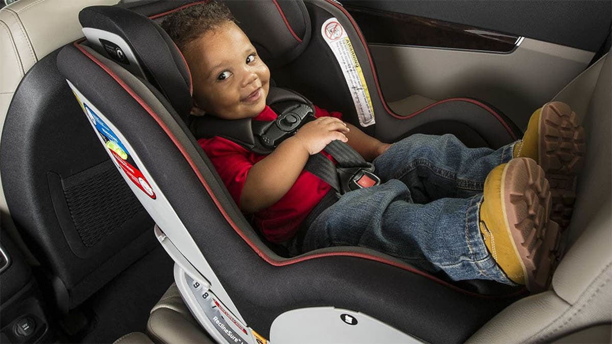 A Little Boy Sitting In Convertible Car Seat