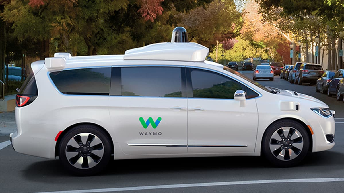A Waymo self-driving car driving on the road.