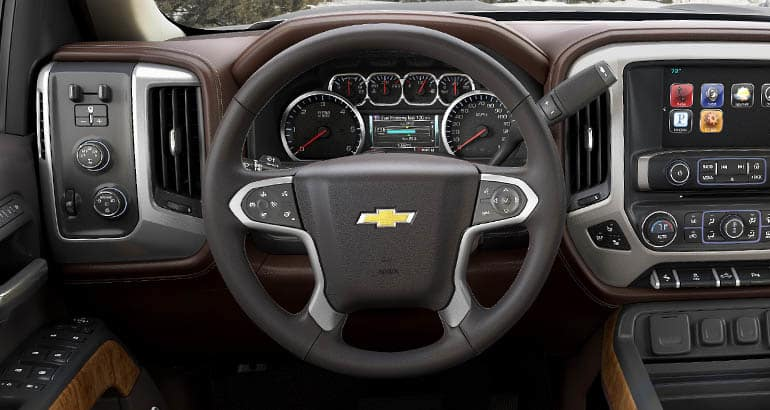The steering wheel of a Chevrolet Suburban, one of the vehicles recalled for a power steering problem. Other vehicles include the Chevrolet Silverado, Cadillac Escalade, and GMC Sierra and Tahoe.