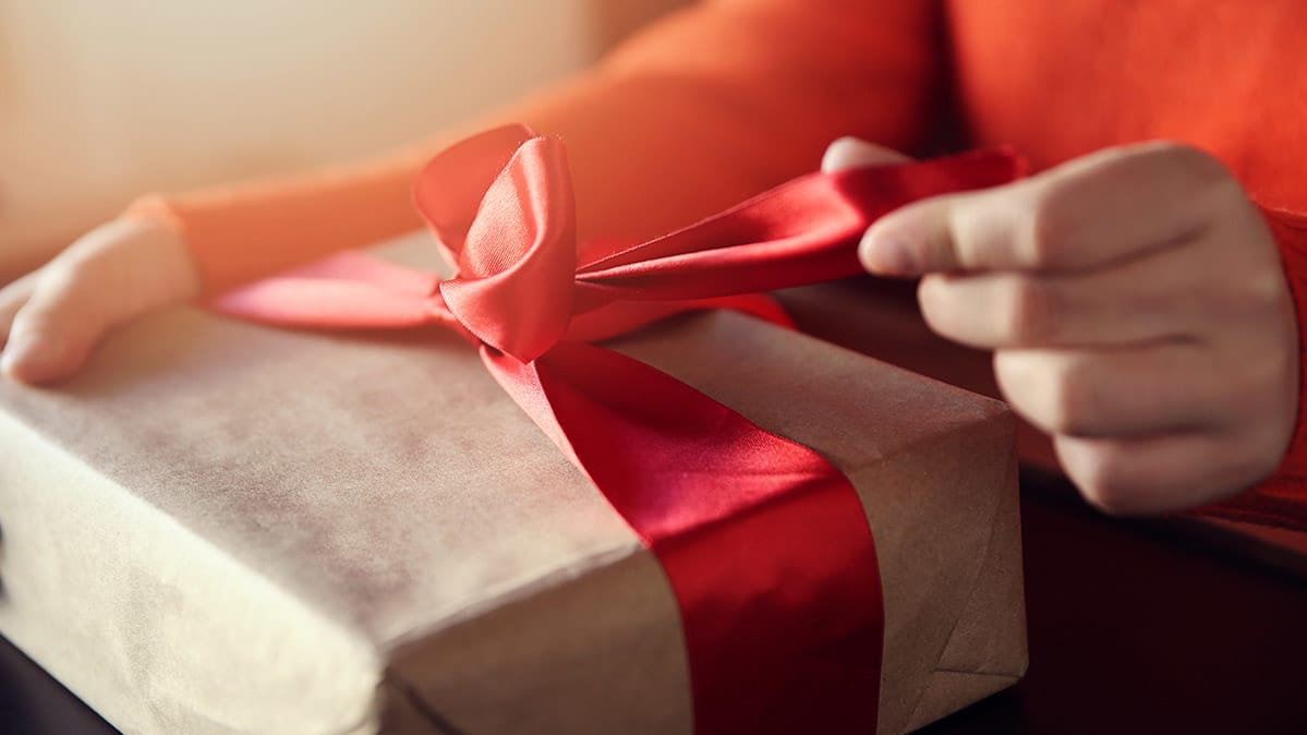 A Person Opening Gift