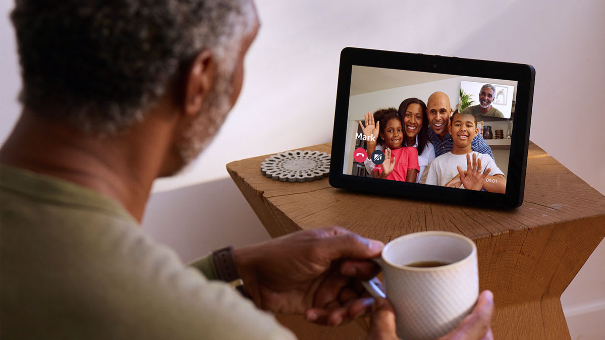 Smart speaker with screen being used for a family video conference