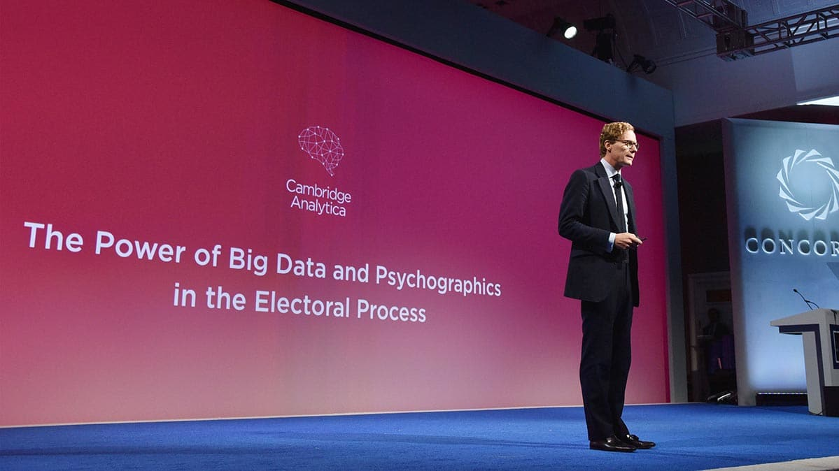 Cambridge Analytica CEO Alexander Nix speaking on a stage