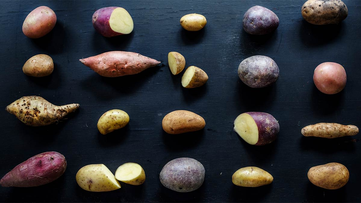 A variety of potatoes on a table.