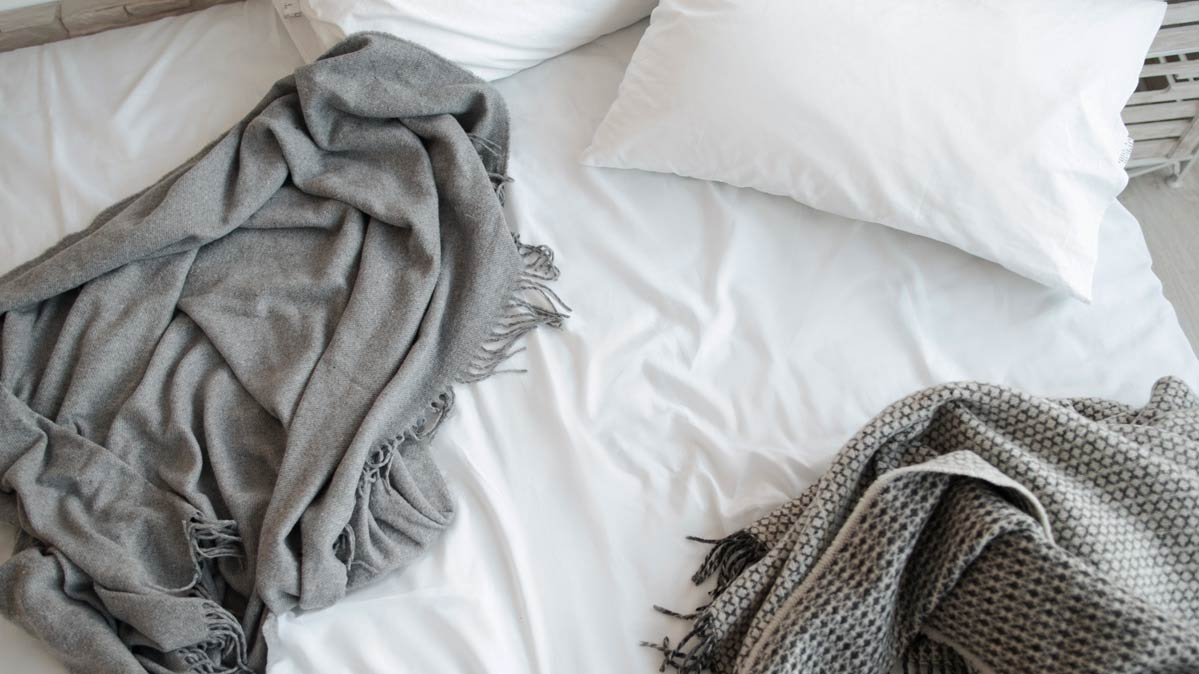 Blankets and pillows on a bed.