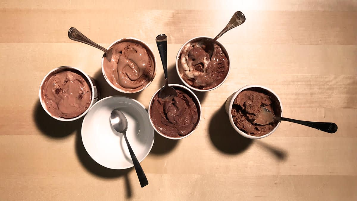 Assortment of chocolate ice cream pints from brands that make healthy ice cream claims.