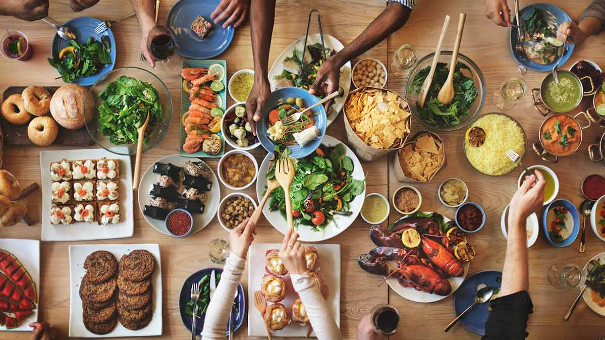 An overhead shot of a table laden with food.