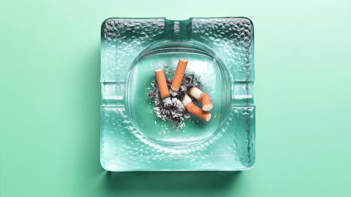 An ashtray containing a cigarette.