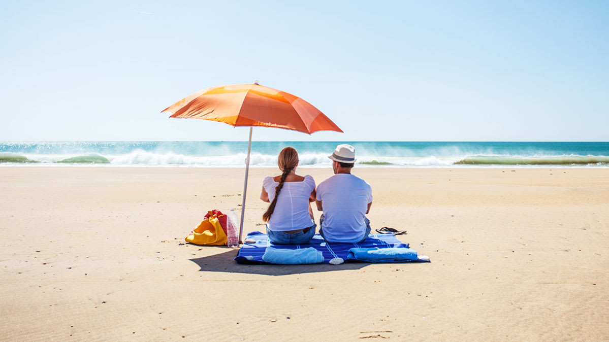 People use an umbrella to prevent sunburn.