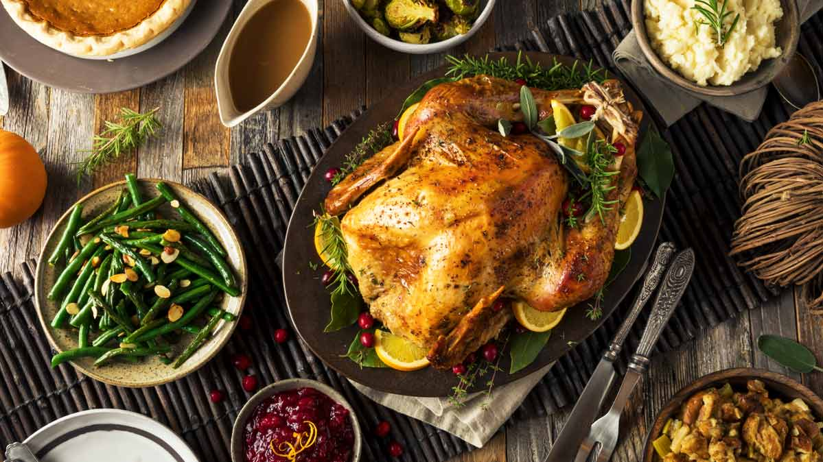 An organic turkey on a table during Thanksgiving dinner.