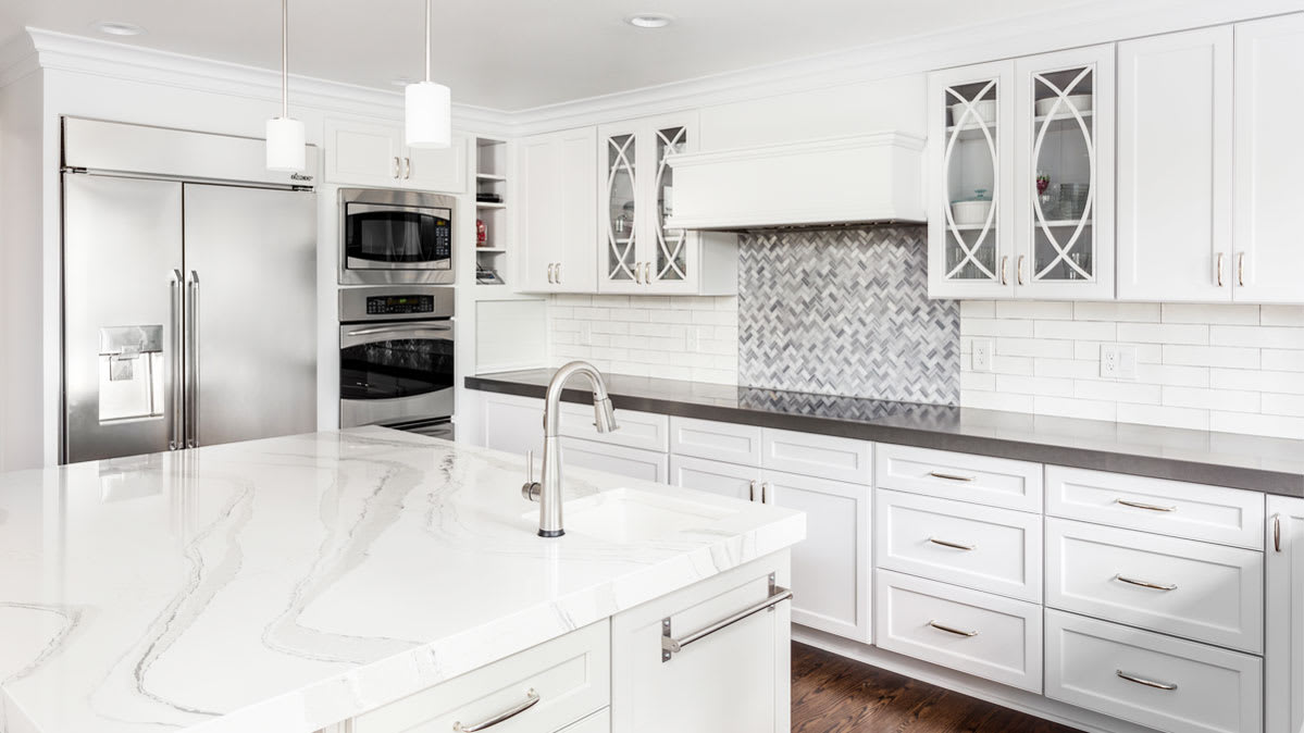 A kitchen with a quartz countertop