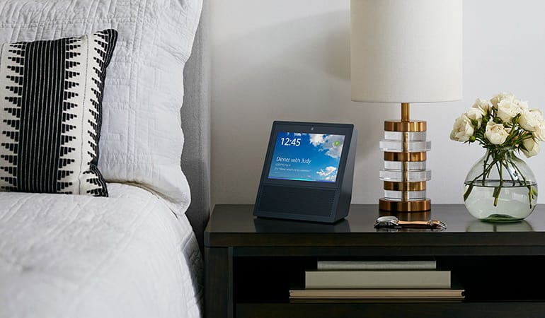 A smart speaker in a bedroom