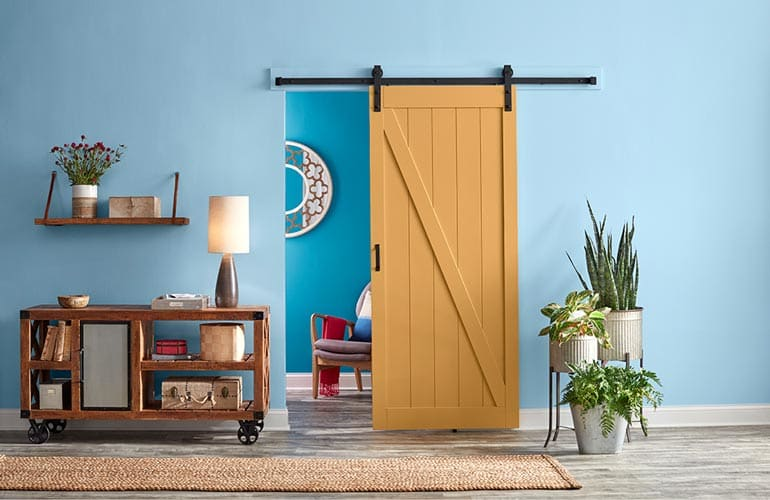 HGTV Home by Sherwin-Williams: Honeycomb HGSW2133 on a stylish interior barn door.