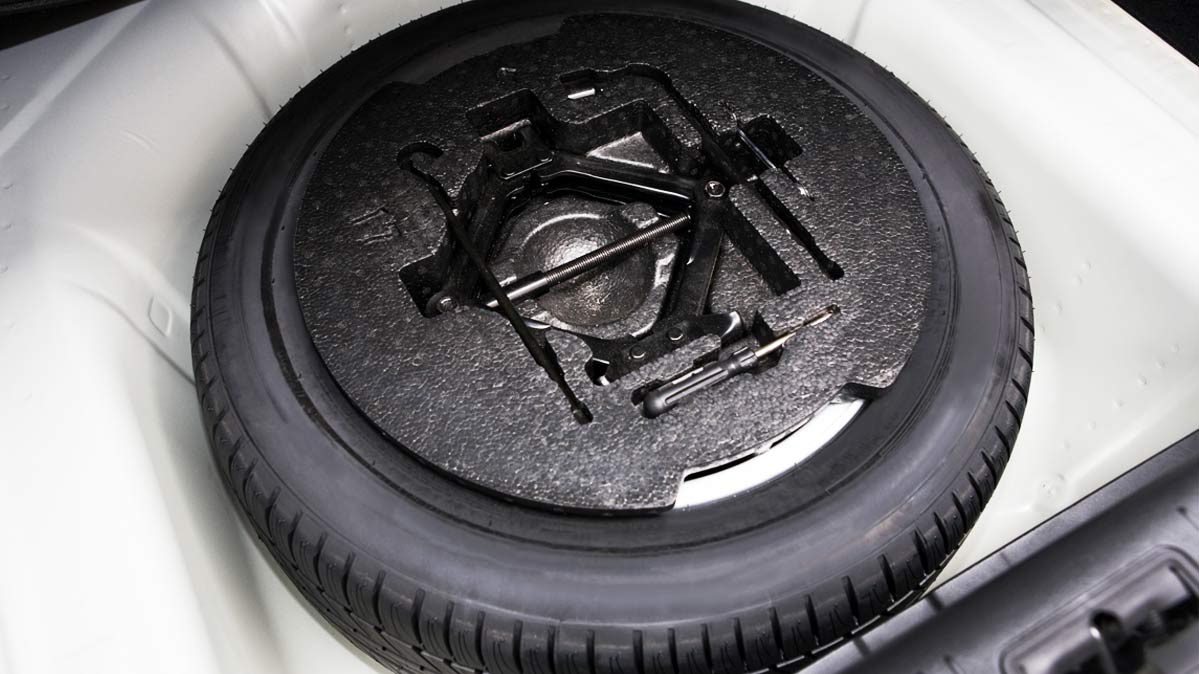 A spare tire in a car.