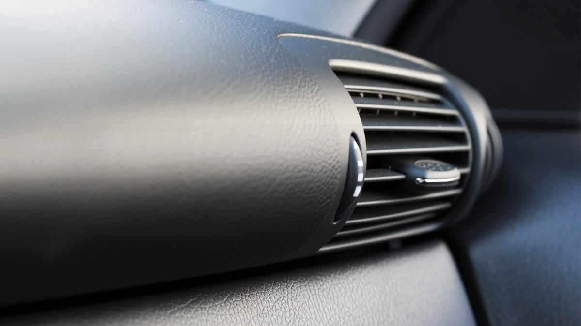An air vent that may be where a car mildew smell is originating from.