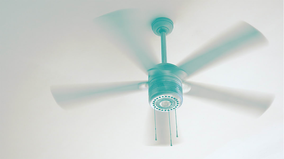 A ceiling fan can help lower utility bills by making it feel cooler.