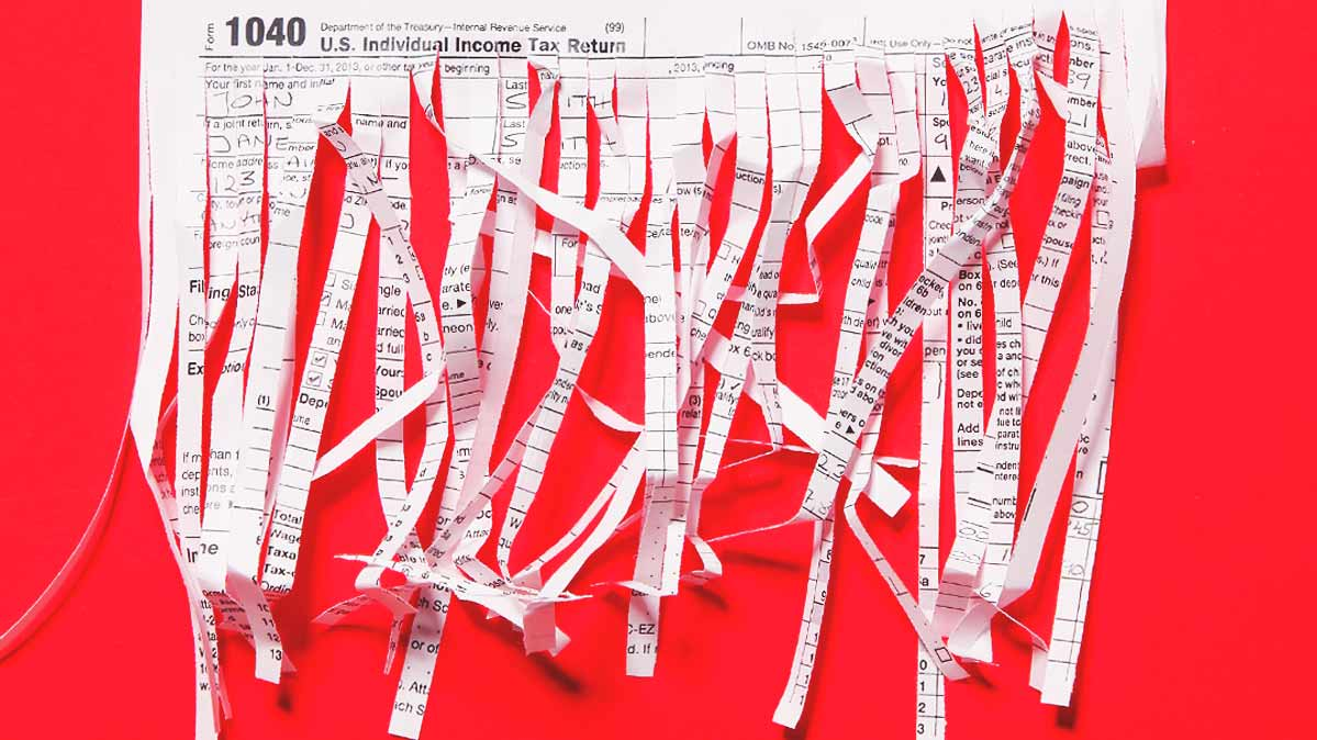 Shredded paper against a red backdrop.