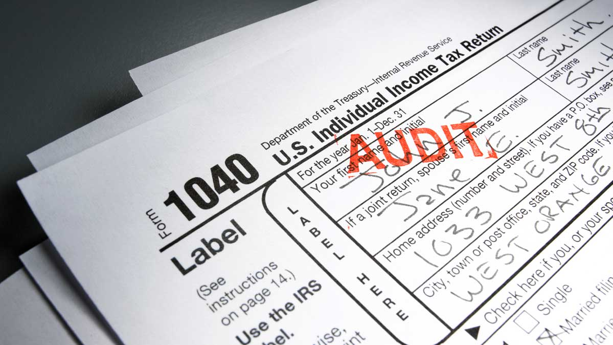 A photo of an IRS 1040 form with a tax audit stamp.