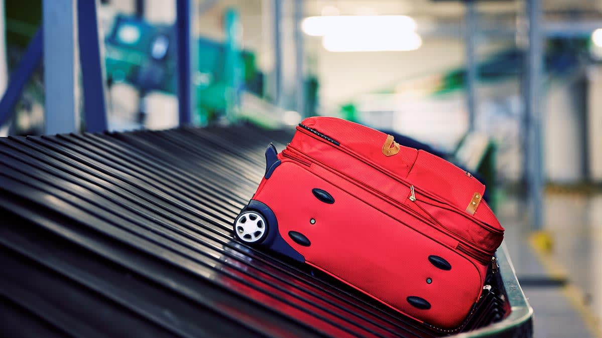 Durable Luggage On A Conveyer Belt At The Airport