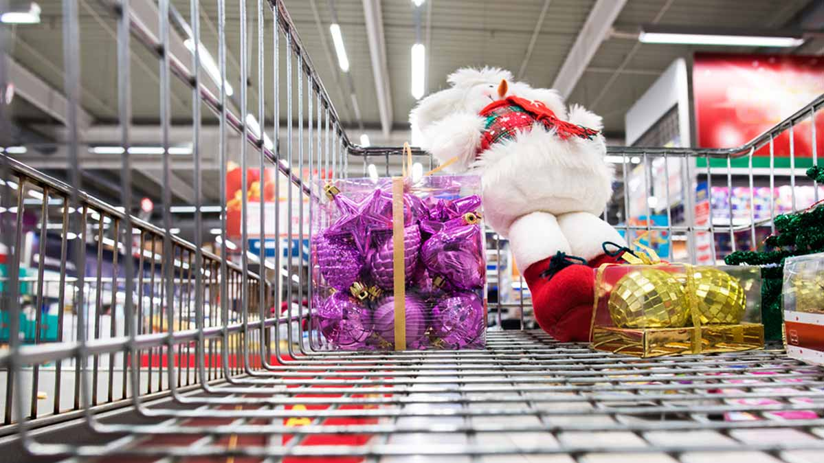 A supermarket cart filled with last-minute holiday gifts
