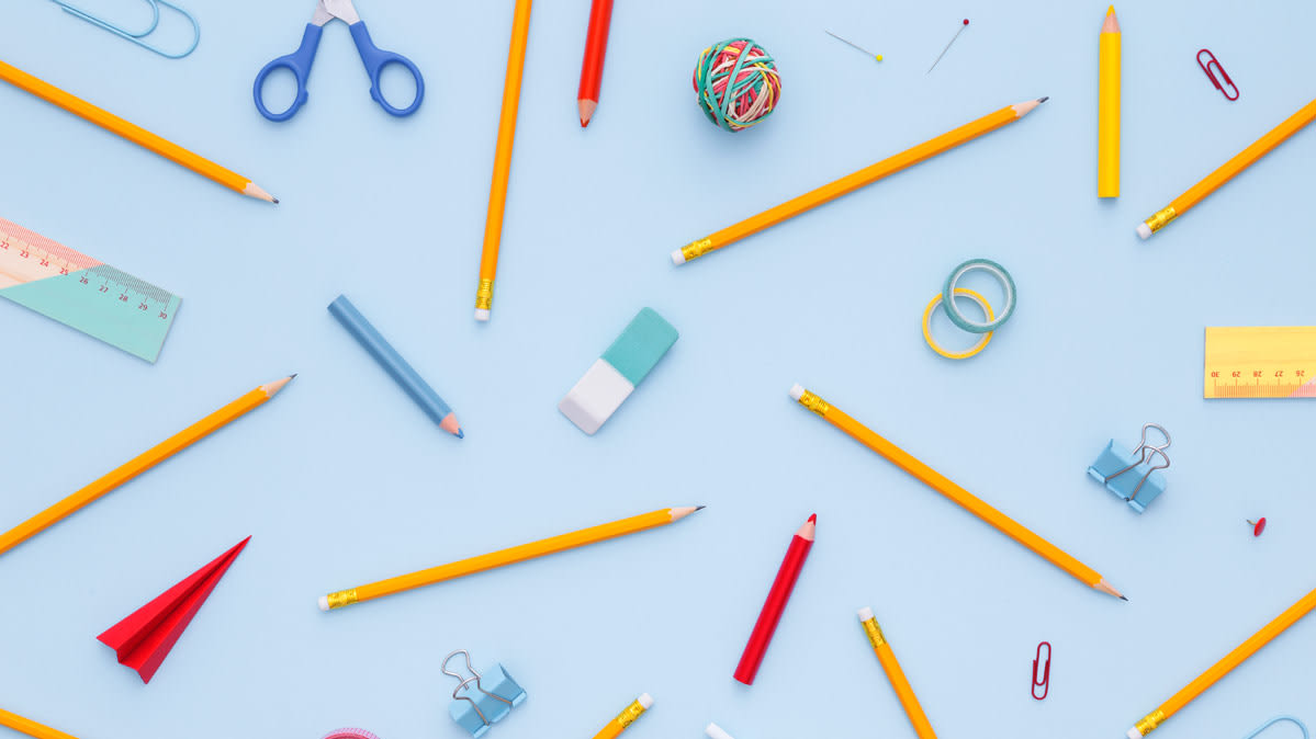 School supplies, including pencils, erasers, and scissors.