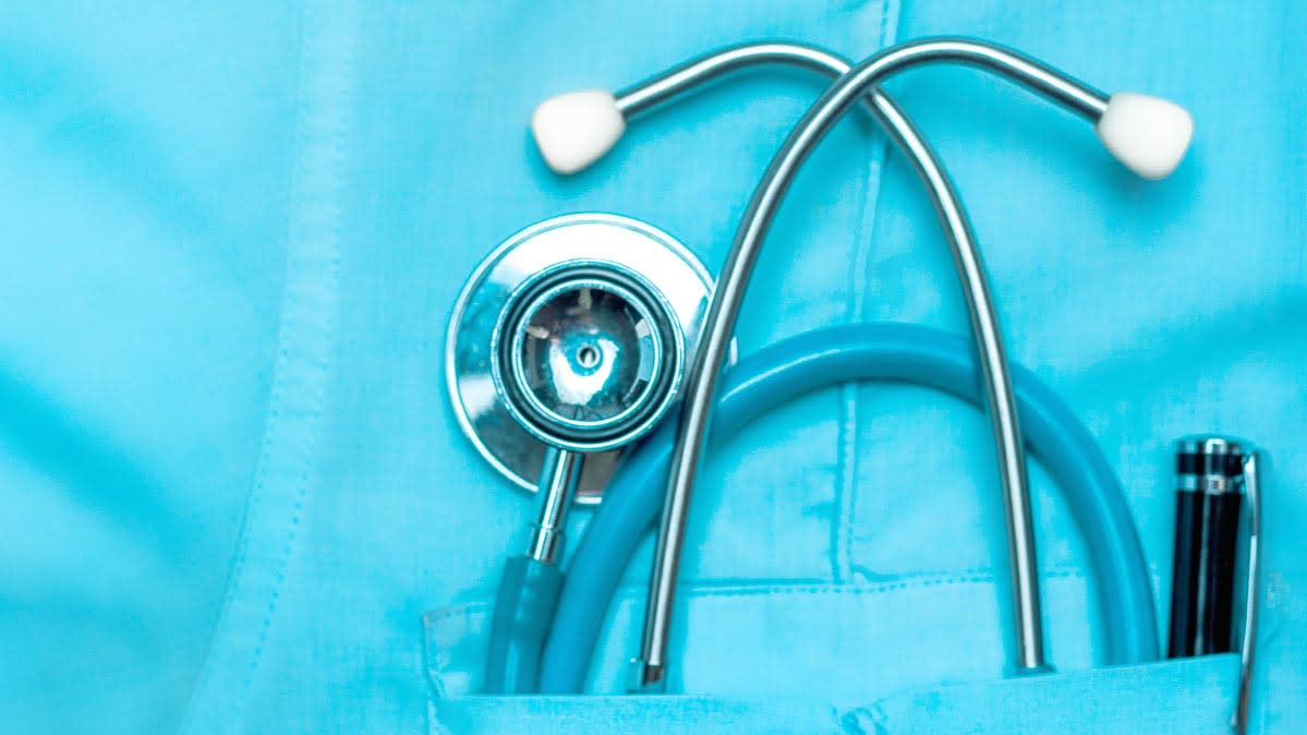 A stethoscope in a doctor's pocket