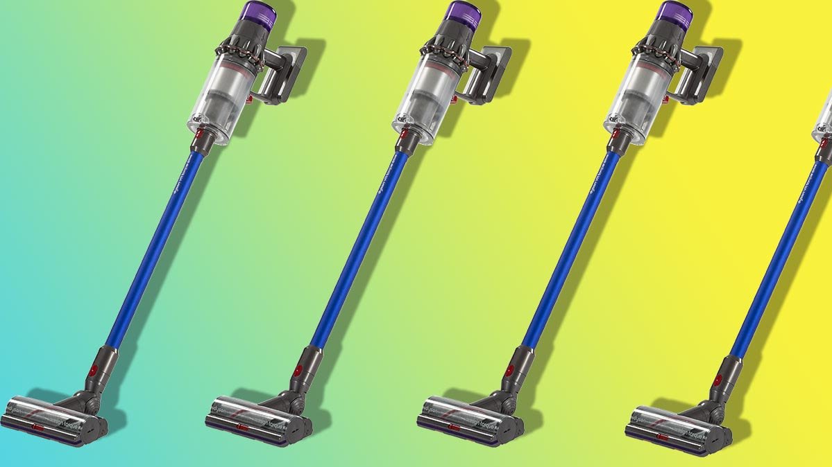 A row of Dyson V11 stick vacuums