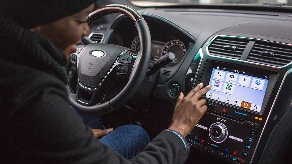 A driver about to reboot a car infotainment system