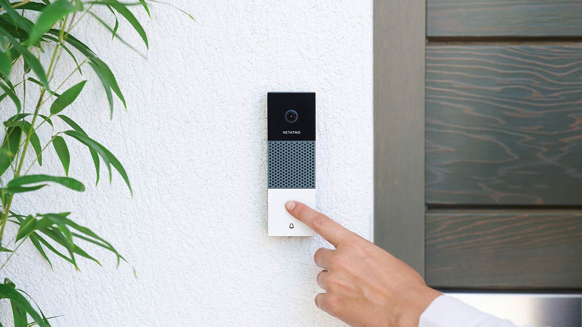 Someone presses the Netatmo Smart Video Doorbell.