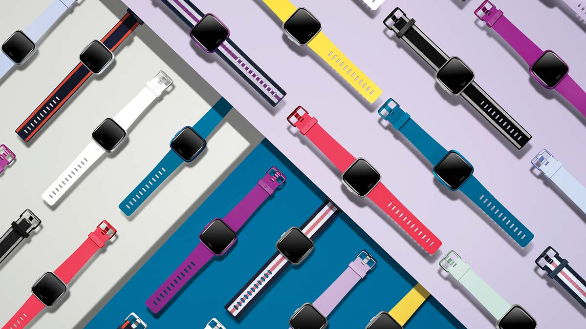 The Fitbit Versa Lite smartwatch outfitted in an assortment of bands.