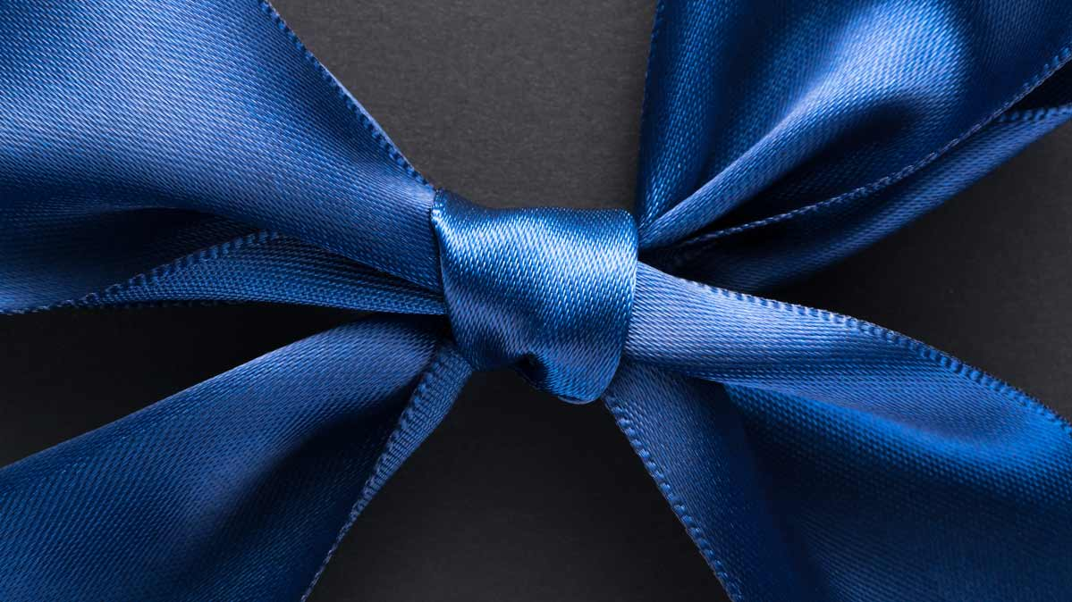 A blue bow wrapped around a gift.