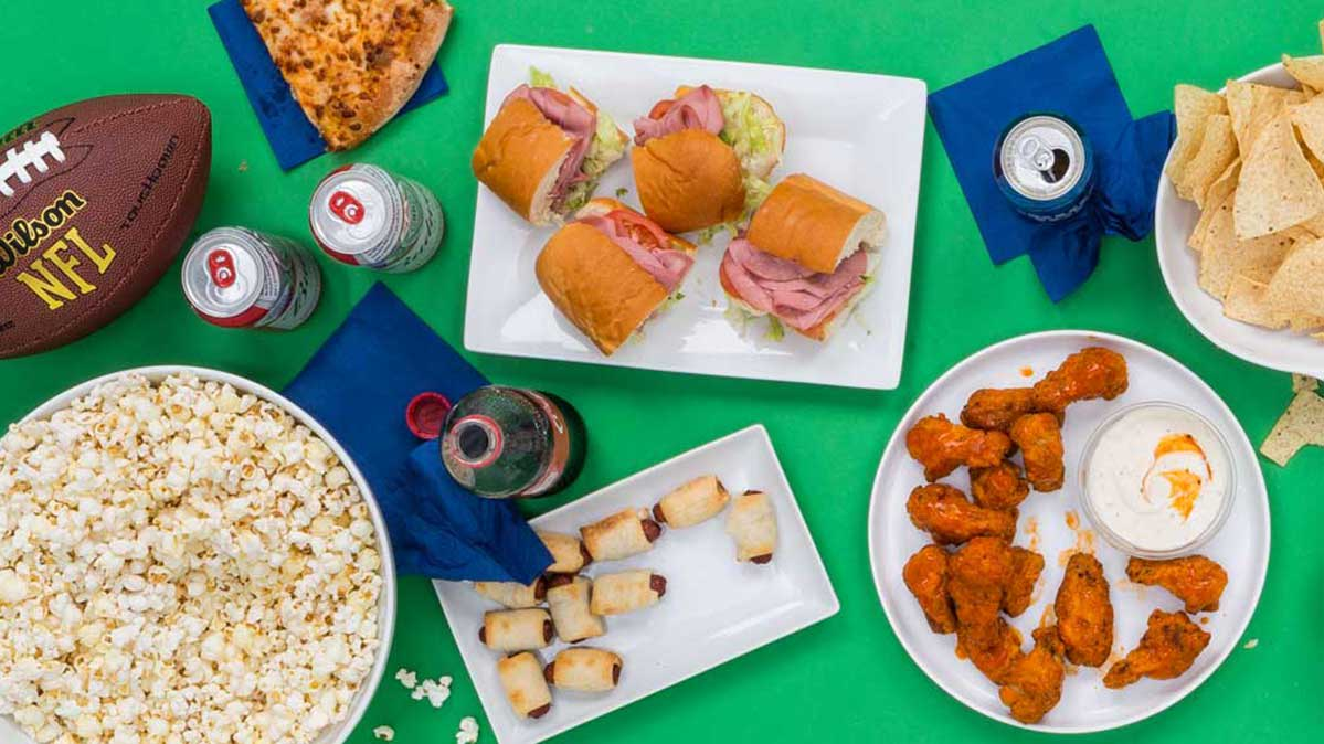 Super Bowl food on a table at a party.