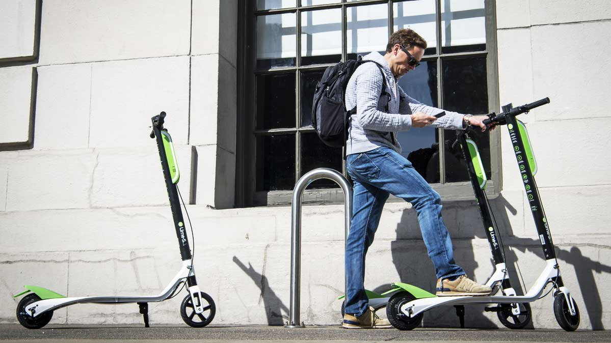 A Rider With Lime Electric Scooter
