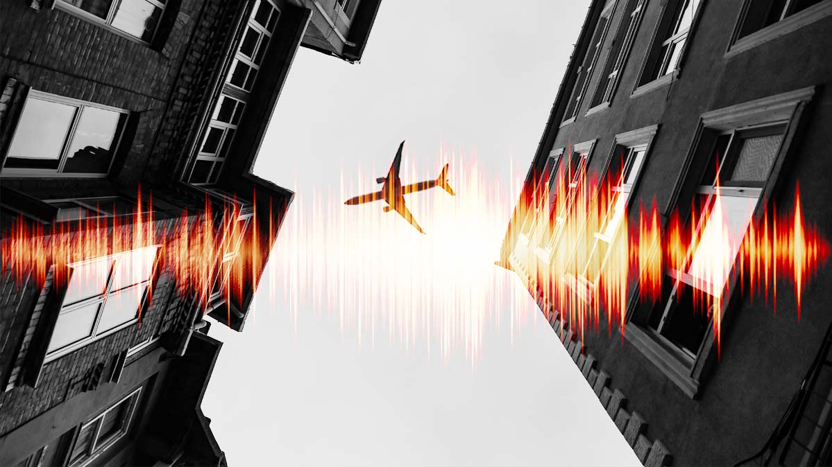 An illustration of a noisy airplane flying over a busy city.