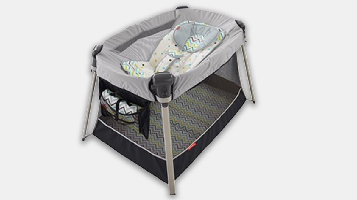 An inclined sleeper accessory attached to a Fisher-Price Ultra-Lite Day & Night Play Yard