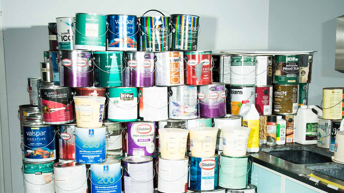 Stacked cans of paint in the test lab.