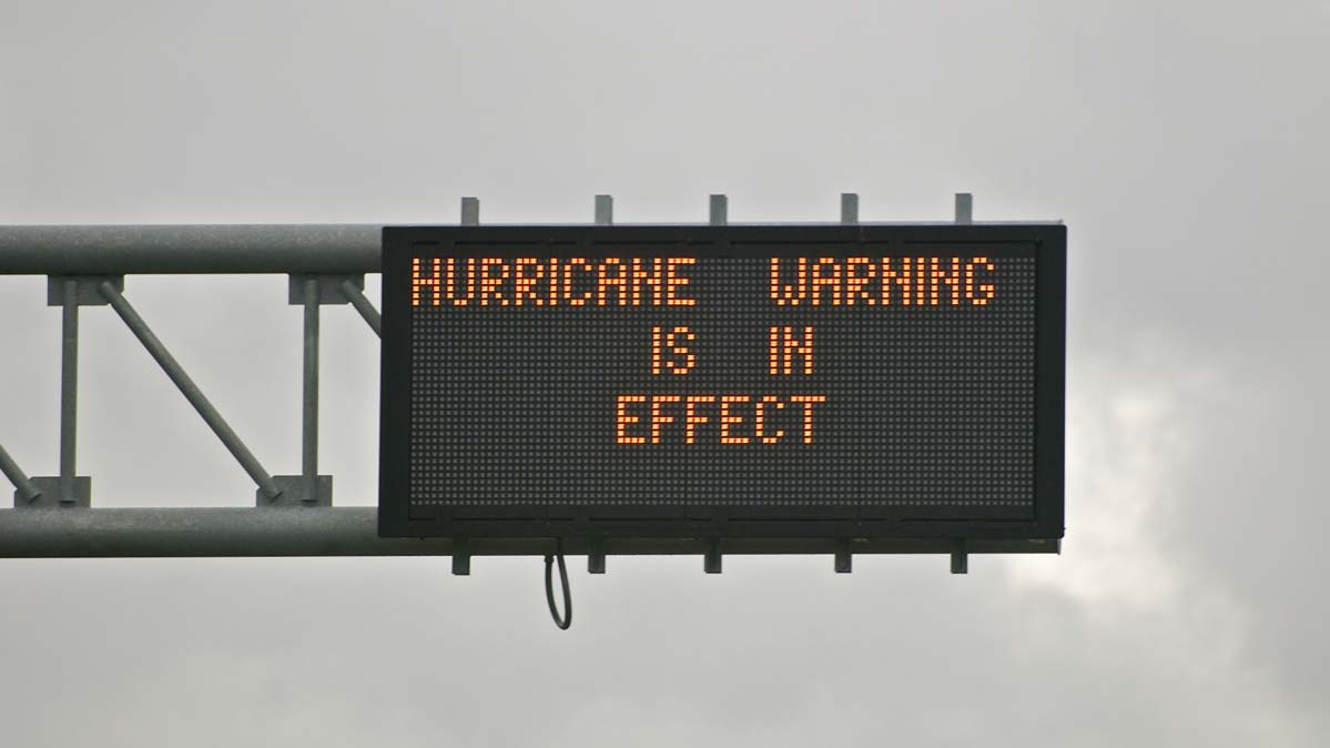 A road sign indicating a hurricane warning in effect