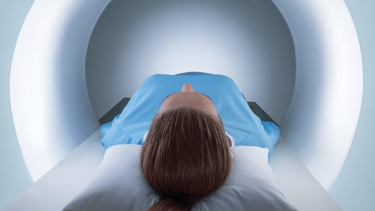 image of woman about to be slid into MRI machine.
