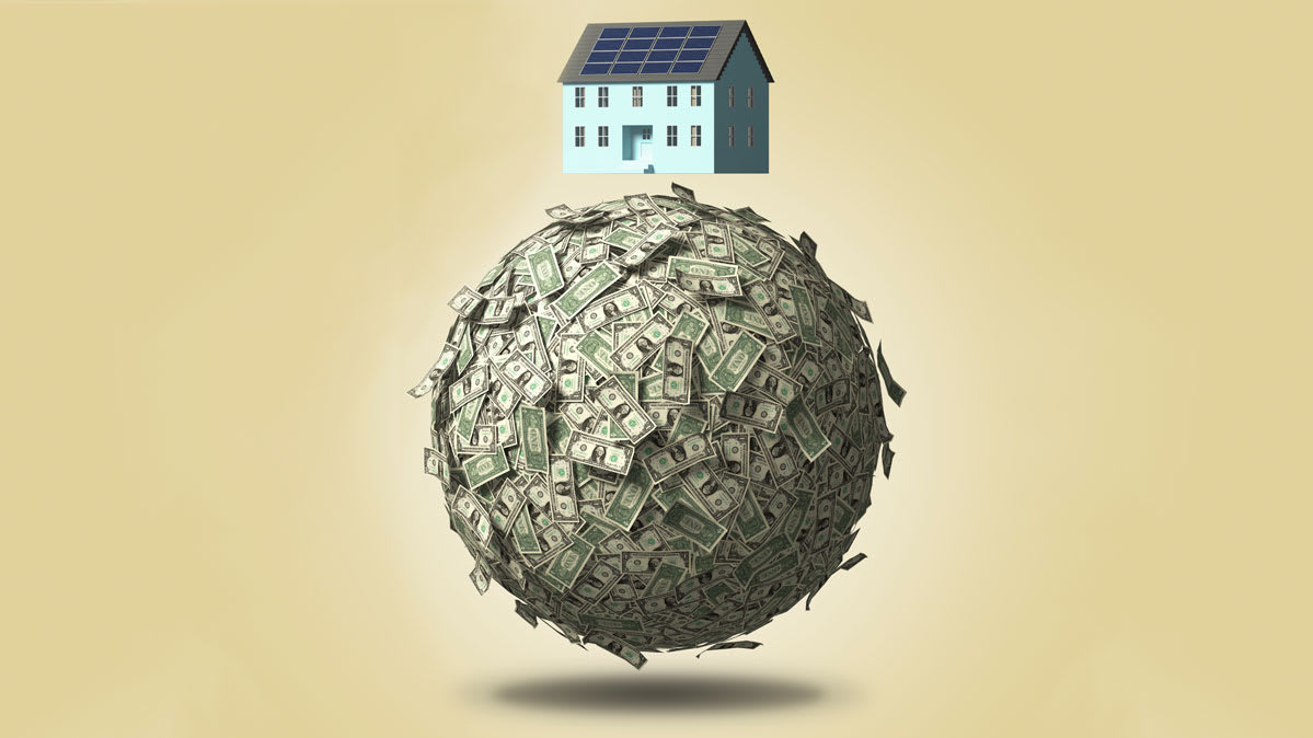 A house sitting on a ball of cash.