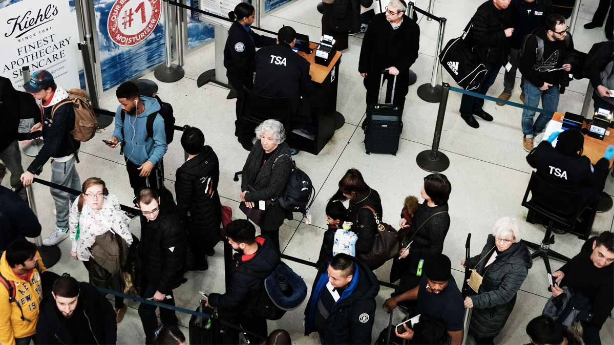 Passengers waiting in airport security lines