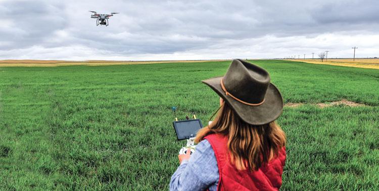 A farmer using a drone