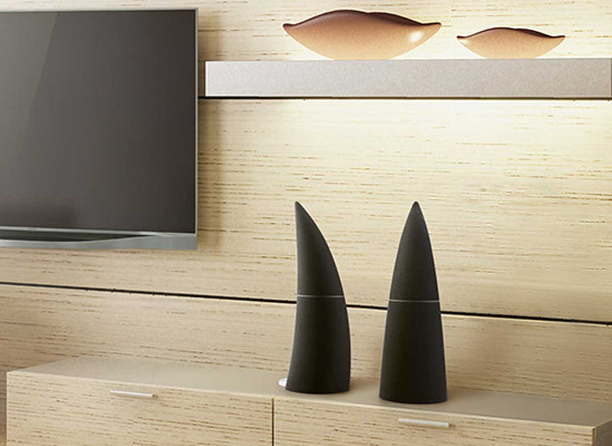 Photo of two Edifier wireless speakers by a TV in someones house.