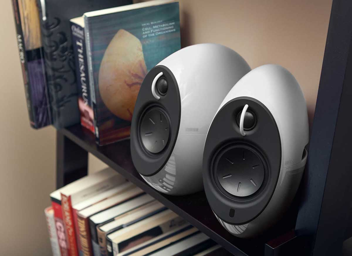 Photo of two Edifier wireless speakers on a bookcase.