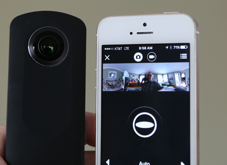 The Ricoh Theta S next to an iPhone with the Theta app