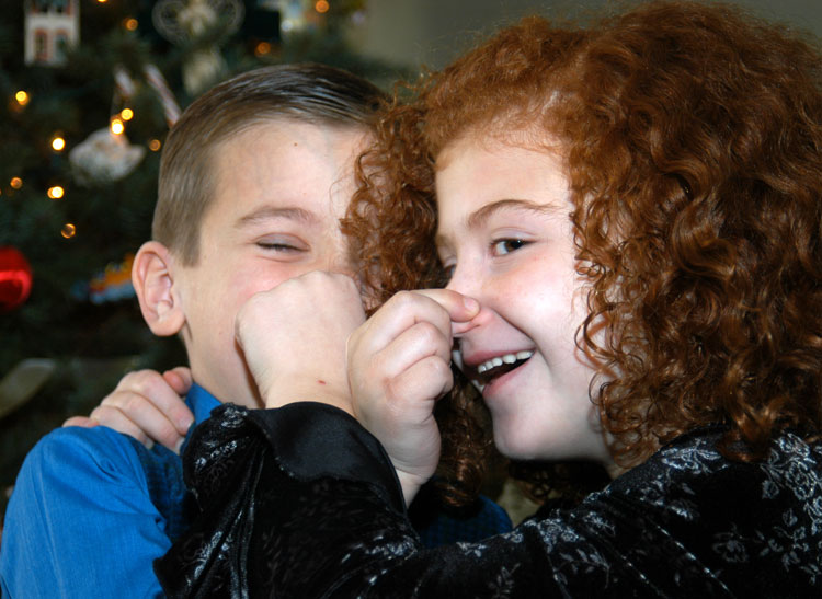 These are photos of two kids pinching each other's noses