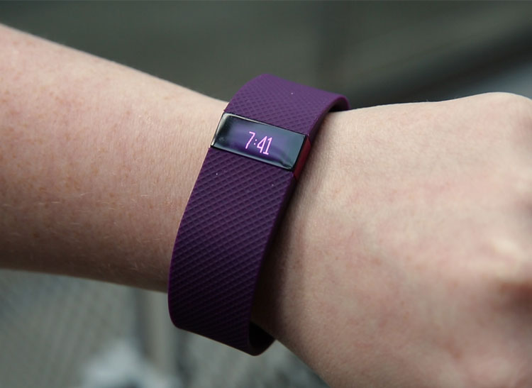 Purple Fitbit Charge HR on woman's wrist for an article on Fitbit heart rate accuracy