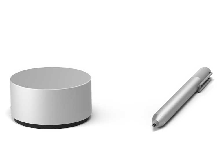 The Surface Dial sitting beside a stylus.