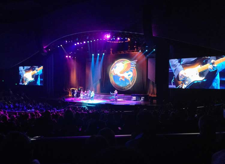Steve Miller and his band on stage, an example of less-than-stellar concert photography