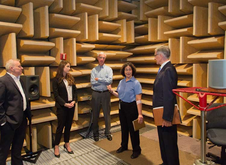 A photo of FCC Chairman Tom Wheeler with staff from Consumer Reports in an anechoic chamber where Consumer Reports tests audio equipment.